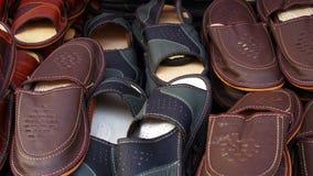 背景空白查出的皮革的拖鞋 免版税库存照片