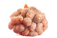 背景空白被包装的土豆 免版税库存照片