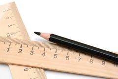 背景空白铅笔的统治者 库存图片