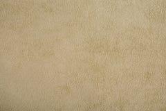 背景米黄自然绒面革 免版税库存照片