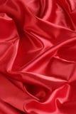 背景红色缎垂直 库存照片