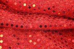 背景红色衣服饰物之小金属片 免版税库存图片