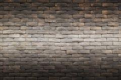 背景纹理深黑色农庄砖墙 免版税库存照片