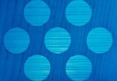 背景纹理渐进性和圈子样式在蓝色塑料 库存图片