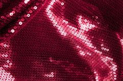 背景纹理,样式 与paillettes的布料红色褐紫红色 免版税库存照片