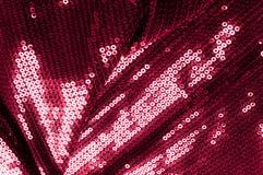 背景纹理,样式 与paillettes的布料红色褐紫红色 库存图片