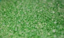 背景绿宝石粒子 免版税库存图片