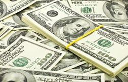 背景美元堆 免版税库存照片