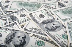 背景美元玻璃查出锁定扩大化的货币s u白色 S 100个票据美元 库存图片