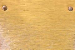 背景老葡萄酒被绘的黄色胶合板 库存图片
