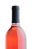 背景脸红在白葡萄酒的瓶 免版税库存照片