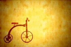背景葡萄酒古董三轮车自行车 免版税库存照片