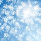 背景蓝色圣诞节雪花 库存照片