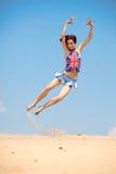 背景蓝色女孩跳的天空年轻人 图库摄影