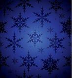 背景蓝色无缝的雪花 库存照片