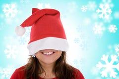 背景蓝色红色圣诞老人微笑的妇女 免版税图库摄影