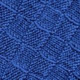 背景蓝色被编织的模式纹理羊毛 免版税库存图片