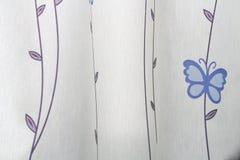 背景蓝色蝴蝶白色 库存图片