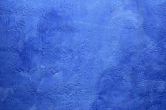 背景蓝色grunge被绘的纹理墙壁 库存图片