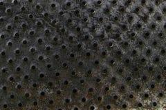 背景表面老,被烧的和生锈金属片与孔 库存照片