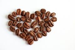 背景豆咖啡重点做白色 免版税库存图片