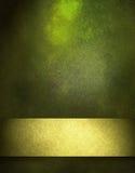 背景金子绿色丝带 库存照片