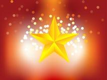 背景金黄光亮的星形 库存照片