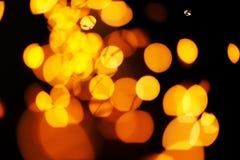 背景金黄光 圣诞灯概念 免版税库存图片