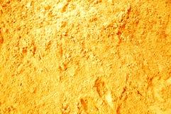 背景金黄沙子被射击的垂直 库存图片