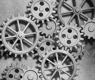 背景钟表机构嵌齿轮齿轮金属 免版税库存照片