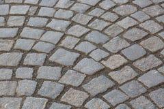 背景铺有鹅卵石的花岗岩路面 石路面纹理 老鹅卵石路面特写镜头抽象背景在Prag 库存照片