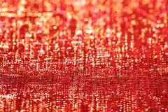 背景闪烁金黄红色闪闪发光 免版税库存照片