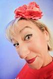 背景颜色狡猾滑稽的生动的妇女 免版税库存照片