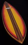 背景黑色五颜六色的冲浪板木头 图库摄影