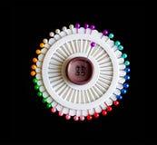背景黑色五颜六色的批次针 图库摄影