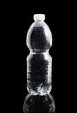 背景黑色瓶塑料 免版税图库摄影