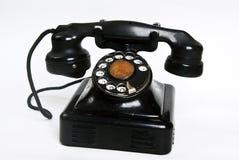 背景黑色老电话白色 免版税库存图片