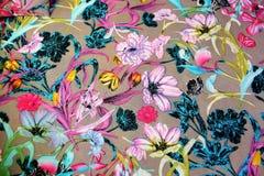 背景织品许多明亮的花 库存照片