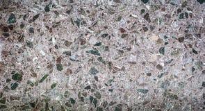 背景黑暗的大理石花岗岩石头  库存图片