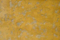 背景水泥纹理墙壁黄色 免版税库存照片