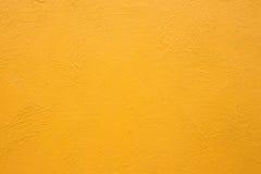 背景水泥纹理墙壁黄色 免版税库存图片