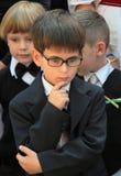 背景玻璃查出男小学生白色 图库摄影