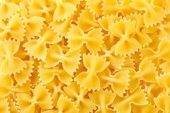背景farfalle意大利面食纹理 库存图片