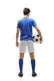 背面图射击了一位少年足球运动员 图库摄影