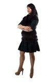 胖墩墩的妇女照片毛皮夹克的,横渡的胳膊 免版税图库摄影