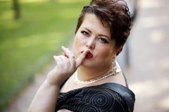 胖的妇女静寂 免版税图库摄影