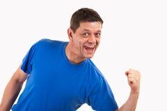 胜利姿势的一个人 免版税库存照片