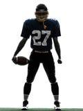 胜利的美国橄榄球运动员人剪影 库存图片