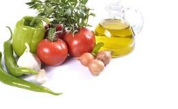 胡椒、大蒜、葱、蕃茄和油 免版税库存照片
