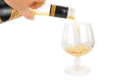 胳膊瓶白兰地酒 库存图片